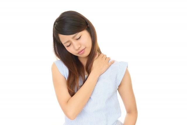 肩こりに苦しむ女性